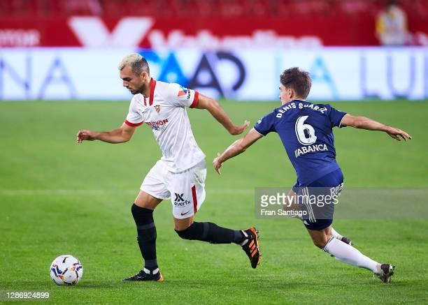 Joan Jordan of Sevilla FC competes for the ball with Denis Suarez of RC Celta de Vigo during the La Liga Santander match between Sevilla FC and RC...