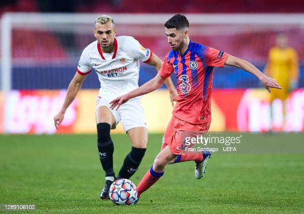 Joan Jordan of Sevilla FC competes for the ball with Jorginho of Chelsea FC during the UEFA Champions League Group E stage match between FC Sevilla...