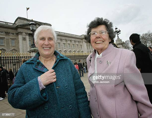 Joan Kell and Joy Ash from Aylesbury in Buckinghamshire smile before attending the Queen's 80th Birthday Lunch on April 19, 2006 at Buckingham Palace...