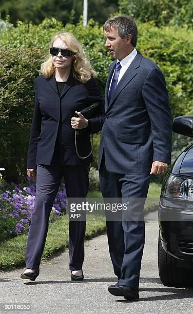 Joan Kennedy former wife of the late Sen Edward M Kennedy is escorted to a waiting car at the Kennedy compound in Hyannis Port Massachusetts on...