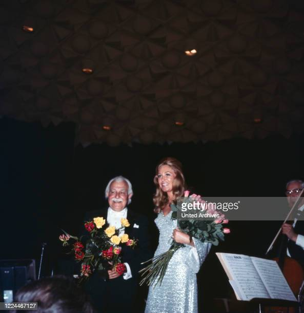 Joan Kennedy wife of American senator Edward Ted Kennedy with orchestra conductor Arthur Fiedler at a soiree while visiting Bonn Germany 1971