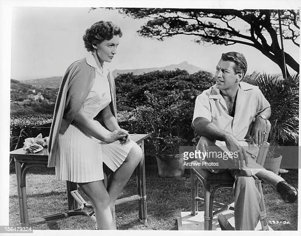 Joan Leslie and Richard Egan talking outside in a scene from the film 'The Revolt Of Mamie Stover' 1956