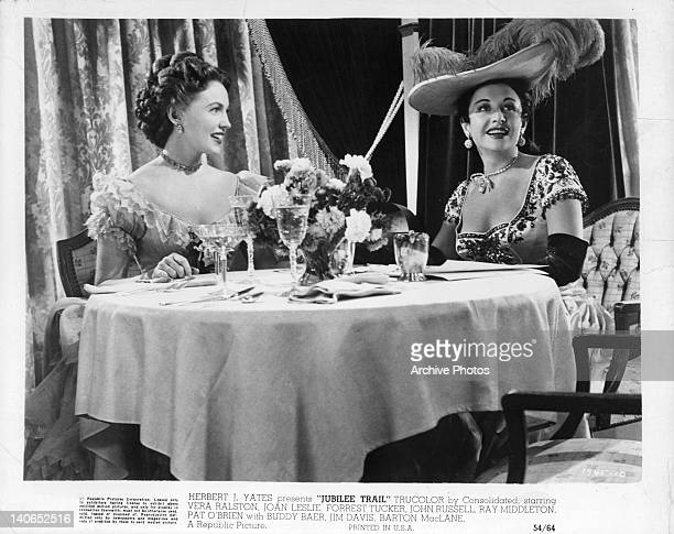Joan Leslie and Vera Ralston sitting at the table in a scene from the film 'Jubilee Trail' 1954