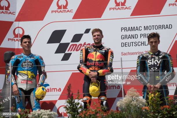 Joan Mir of Spain and EG 00 Marc VDS Brad Binder of South Africa and Red Bull KTM Ajo and Luca Marini of Italy and Sky Racing Team VR46 celebrate on...