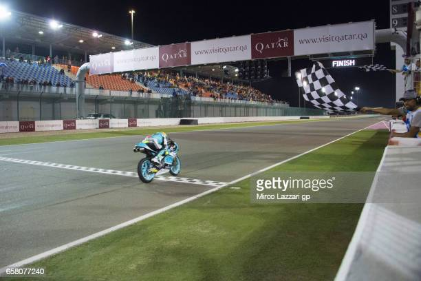 Joan Mir of Spain and Leopard Racing cuts the finish lane and celebrates the victory at the end of the Moto3 race during the MotoGp of Qatar Race at...