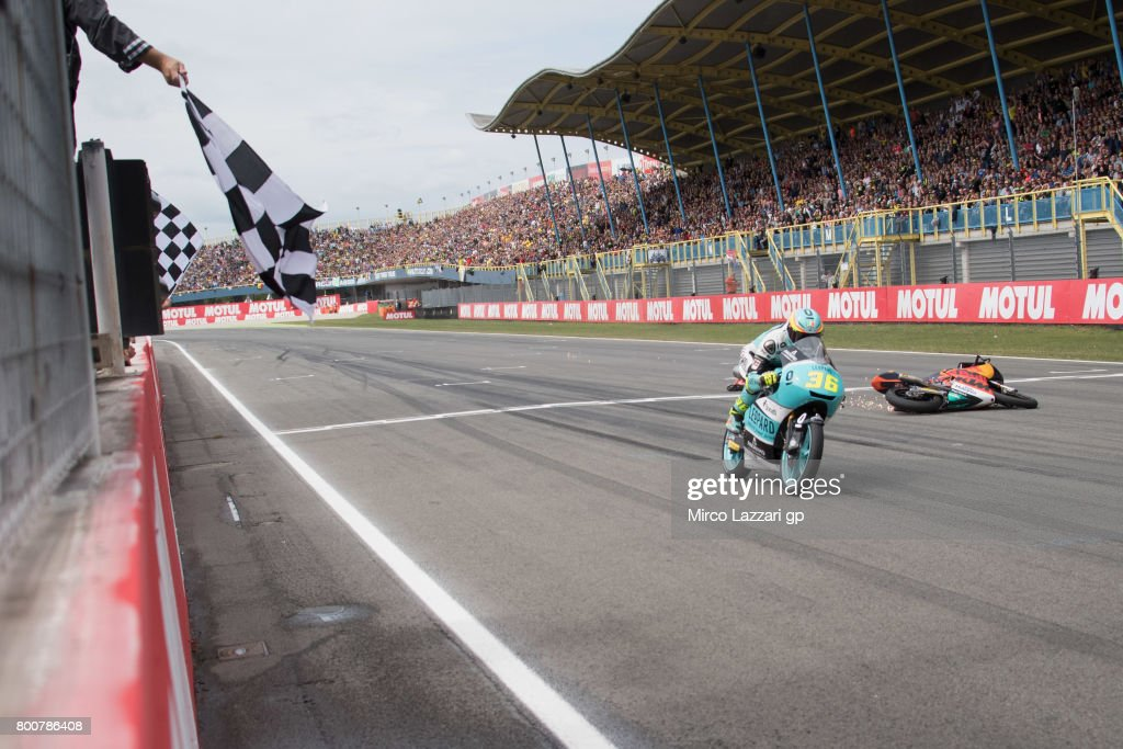 Joan Mir of Spain and Leopard Racing cuts the finish line and Bo Bendsneyder of Netherlands and Red Bull KTM Ajo (R) crashes during the Moto3 Race during the MotoGP Netherlands - Race on June 25, 2017 in Assen, Netherlands.