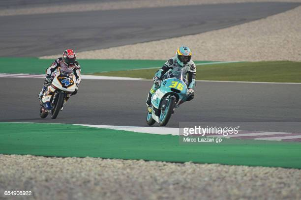 Joan Mir of Spain and Leopard Racing leads Patrick Pulkkinen of Finland and Peugeot MC Saxoprint during Moto2 And Moto3 Tests In Losail at Losail...