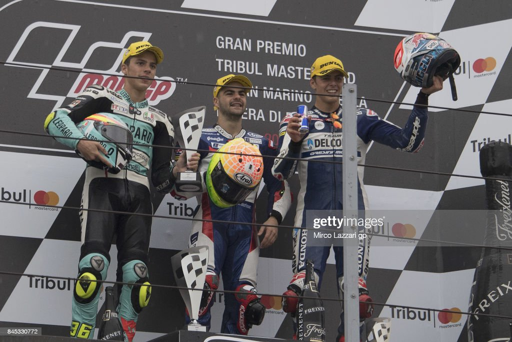 Joan Mir of Spain and Leopard Racing; Romano Fenati of Italy and Marinelli Rivacold Snipers Team and Fabio Di Giannantonio of Italy and Del Conca Gresini Moto3 pose on th podium at the end of the Moto3 Race during the MotoGP of San Marino - Race at Misano World Circuit on September 10, 2017 in Misano Adriatico, Italy.