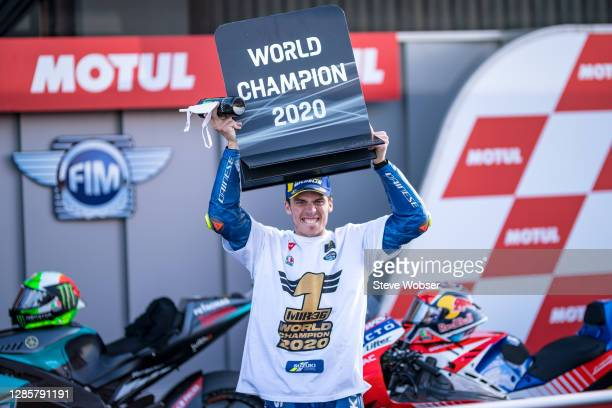 Joan Mir of Spain and Team SUZUKI ECSTAR celebrates after winning his first MotoGP title during the MotoGP of Comunitat Valenciana at Comunitat...