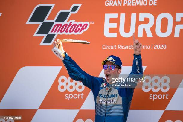 Joan Mir of Spain and Team SUZUKI ECSTAR celebrates the Suzuki double podium and first ever MotoGP win on the podium with his trophy during the...