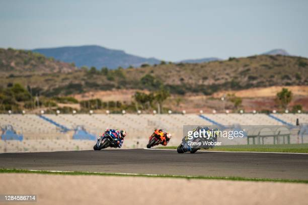 Joan Mir of Spain and Team SUZUKI ECSTAR leads in front of Alex Rins of Spain and Team SUZUKI ECSTAR and Pol Espargaro of Spain and Red Bull KTM...