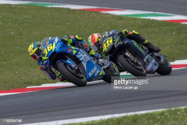 Joan Mir of Spain and Team Suzuki ECSTAR leads Valentino Rossi of Italy and Yamaha Factory Racing during the MotoGP race during the MotoGp of Italy -...