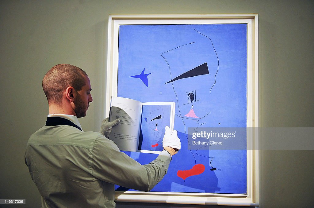 Joan Miro's 'Peinture (Etoile Blueu)' is placed on a wall at Sotheby's on June 14, 2012 in London, England. This is among the most important works by the artist ever to come to auction and is expected to fetch an estimated £15-20 million. This piece is part of the Impressionist & Modern and Contemporary Art sale at Sotheby's which will be held on June 19, 2012 and June 20, 2012.