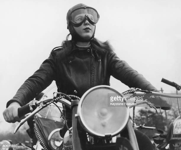 Joan Nimlo, aged 19, riding her BSA motorbike in Bellrose, Queens, during a meeting of an all female motorbike club, February 1950. .