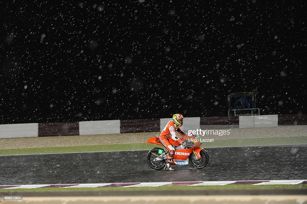 Joan Olive of Spain and Derbi Racing Team rides his bike during the torrential rain flooded in the desert during the 125 cc. race to the Motorcycle Grand Prix of Doha on April 11, 2009 in Doha, Qatar.