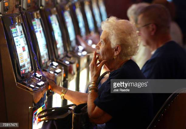 Joan Ouellette plays a slot machine May 11 2004 during the grand opening for the Seminole Hard Rock Hotel and Casino in Hollywood Florida South...