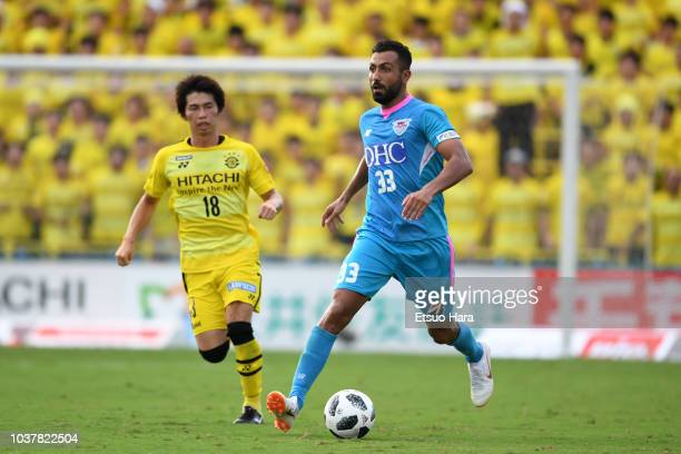 Joan Oumari of Sagan Tosu and Yusuke Segawa of Kashiwa Reysol compete for the ball during the JLeague J1 match between Kashiwa Reysol and Sagan Tosu...