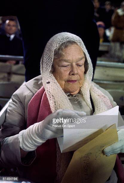 Joan Payson owner of the New York Mets looks through some paper work during the World Series featuring the Oakland Athletics and New York Mets at...