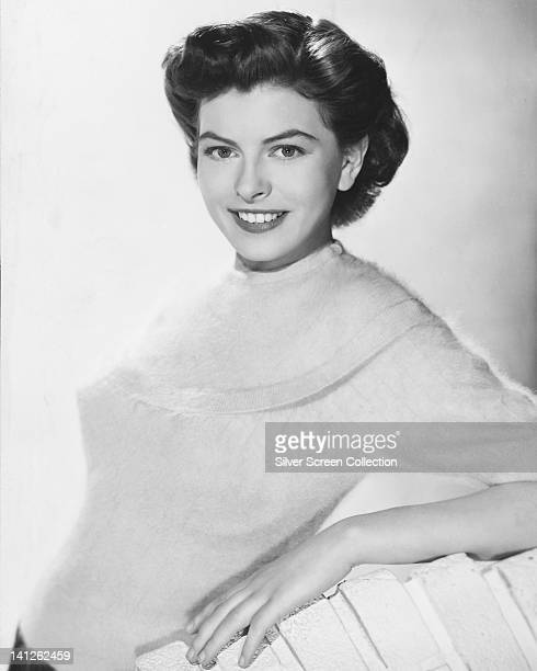 Joan Rice , British actress, wearing a white angora jumper, smiling in a studio portrait, against a white background, circa 1955.