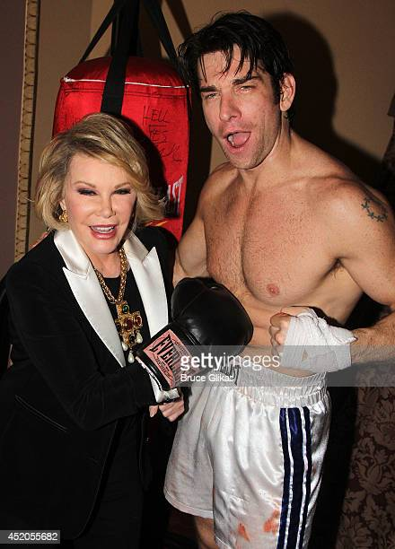 Joan Rivers and Andy Karl as Rocky Balboa pose backstage at the hit musical Rocky on Broadway at The Winter Garden Theater on July 11 2014 in New...