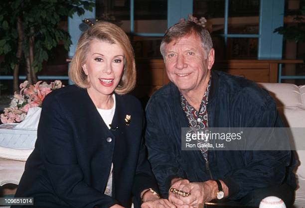 Joan Rivers and Mickey Mantle during 'Can We Shop' Telethon May 1994 at CBS Broadcast Center in New York City New York United States