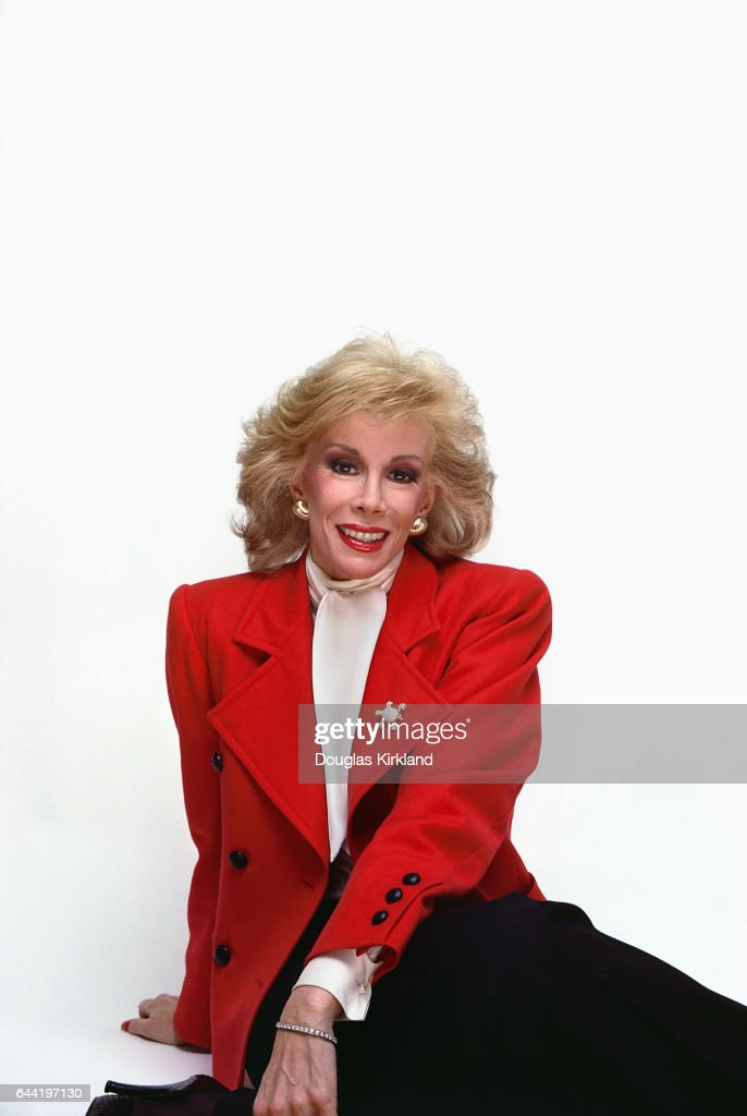 Joan Rivers in Red Jacket and Black Skirt