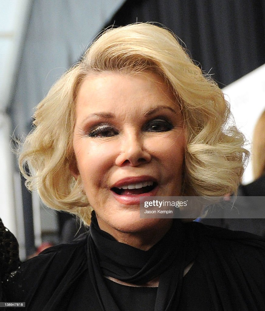 Joan Rivers poses backstage at the Badgley Mischka Fall 2012 fashion show during Mercedes-Benz Fashion Week at The Theatre at Lincoln Center on February 14, 2012 in New York City.