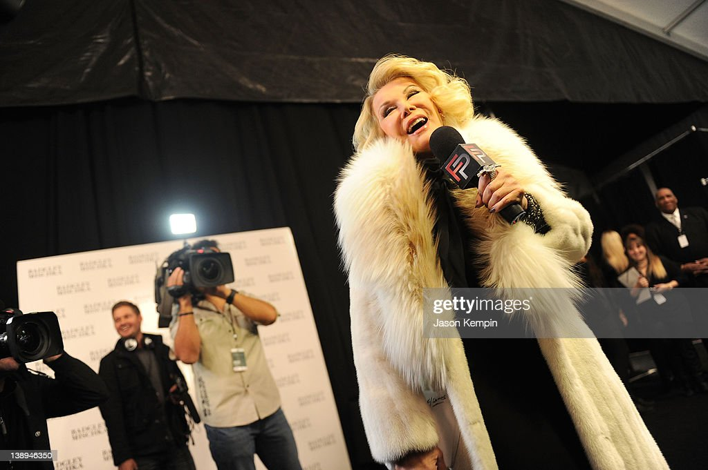 Joan Rivers speaks backstage at the Badgley Mischka Fall 2012 fashion show during Mercedes-Benz Fashion Week at The Theatre at Lincoln Center on February 14, 2012 in New York City.