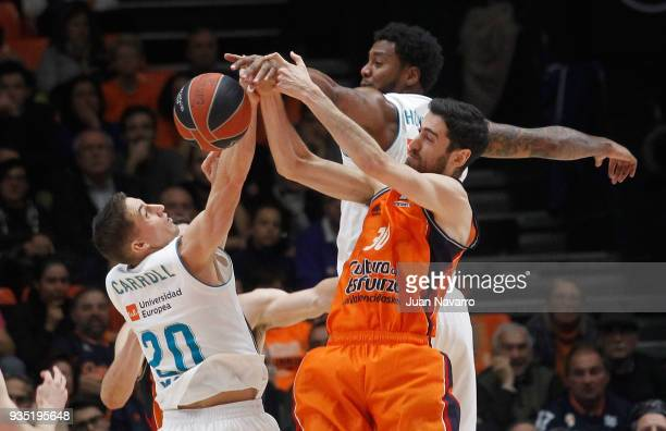 Joan Sastre #30 of Valencia Basket competes with Jaycee Carroll #20 of Real Madrid during the 2017/2018 Turkish Airlines EuroLeague Regular Season...