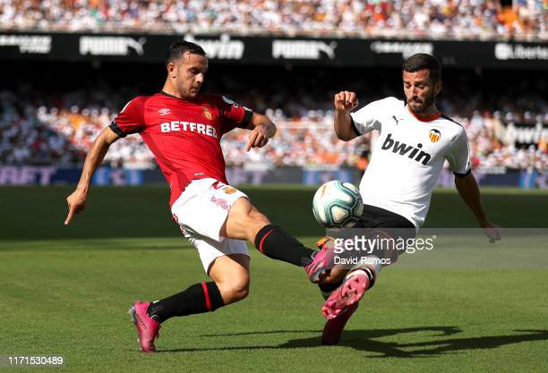 Joan Sastre of Mallorca is tackled by Jose Luis Gaya of Valencia during the Liga match between Valencia CF and RCD Mallorca at Estadio Mestalla on...
