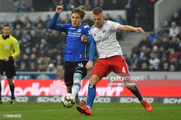 Joan Simun Edmundsson of Bielefeld and Rick van Drongelen of Hamburg fight for the ball during the Second Bundesliga match between DSC Arminia...