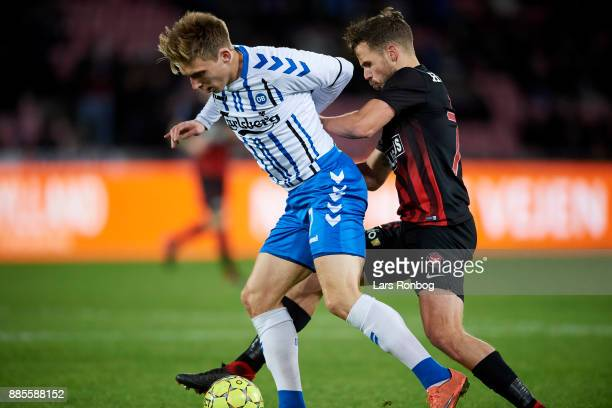 Joan Simun Edmundsson of OB Odense and Filip Novak of FC Midtjylland compete for the ball during the Danish Alka Superliga match between FC...