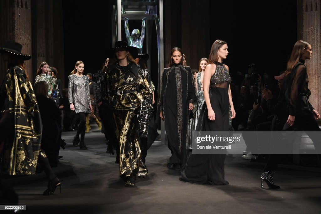 Joan Smalls and Bella Hadid and models walk the runway at the Alberta Ferretti show during Milan Fashion Week Fall/Winter 2018/19 on February 21, 2018 in Milan, Italy.