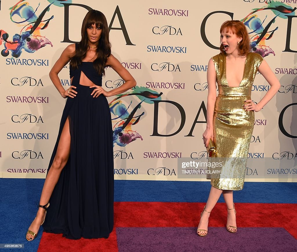 Joan Smalls and Karen Olsen attend the 2014 Council of Designers of America Awards (CFDA)at Alice Tully Hall at the Lincoln Center June 2, 2014 in New York City. AFP PHOTO / Timothy A. CLARY