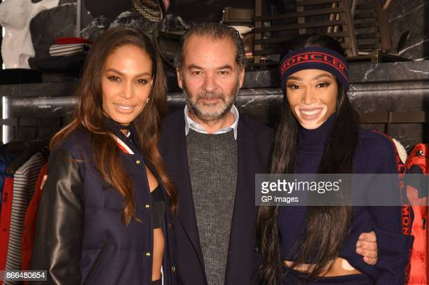 Joan Smalls CEO and Chairman of Moncler Remo Ruffini and Winnie Harlow attend the Moncler cocktail in celebration of the boutique grand opening on...