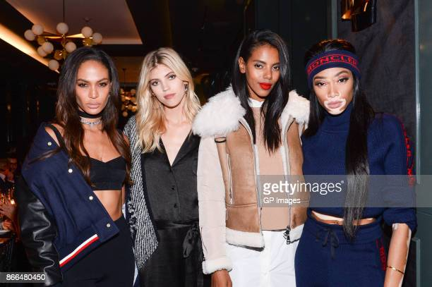 Joan Smalls Devon Windsor Grace Mahary and Winnie Harlow attend the Moncler dinner in celebration of the boutique grand opening on October 25 2017 in...