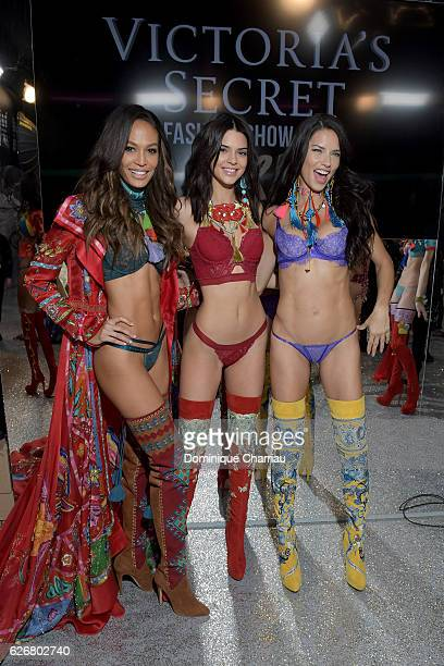 Joan Smalls Kendall Jenner and Adriana Lima pose backstage during the Victoria's Secret Fashion Show on November 30 2016 in Paris France
