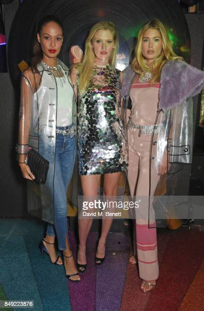 Joan Smalls Lara Stone and Doutzen Kroes attend the LOVE magazine x Miu Miu party held during London Fashion Week at Loulou's on September 18 2017 in...