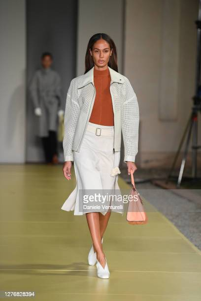 Joan Smalls walks the runway at the Salvatore Ferragamo fashion show during the Milan Women's Fashion Week on September 26, 2020 in Milan, Italy.