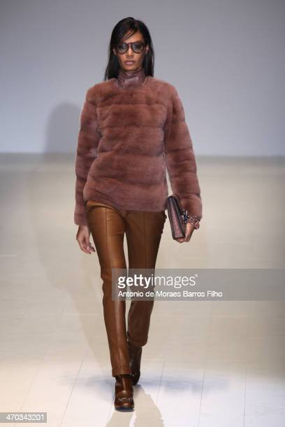 Joan Smalls walks the runway during the Gucci show as a part of Milan Fashion Week Womenswear Autumn/Winter 2014 on February 19 2014 in Milan Italy