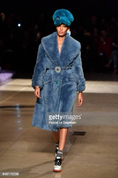 Joan Smalls walks the runway during the Miu Miu show as part of the Paris Fashion Week Womenswear Fall/Winter 2017/2018 on March 7 2017 in Paris...