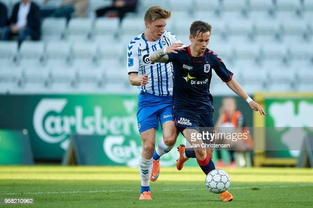 Joan Símun Edmundsson of OB Odense and Jakob Ankersen of AGF Arhus compete for the ball during the Danish Alka Superliga match between OB Odense and...