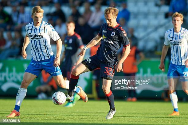 Joan Símun Edmundsson of OB Odense and Martin Pusic of AGF Arhus compete for the ball during the Danish Alka Superliga match between OB Odense and...