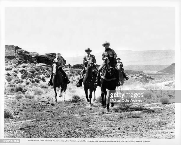 Joan Staley and Warren Stevens lead a posse into an abandoned Spanish pueblo in a scene from the film 'Gunpoint' 1966