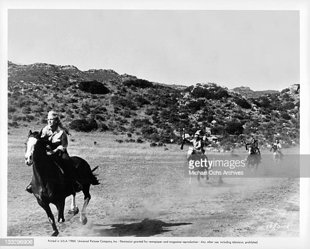 Joan Staley hangs on when her horse is spooked by attacking Indians in a scene from the film 'Gunpoint' 1966