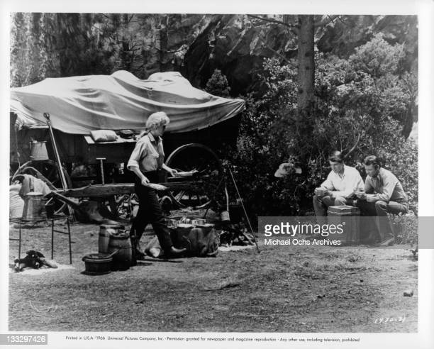 Joan Staley serves a makeshift dinner to David Macklin in a scene from the film 'Gunpoint' 1966