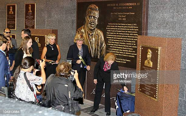 Joan Steinbrenner leaves a rose at the monument of her late husband George Steinbrenner followed by daughters Jessica Steinbrenner and Jennifer...