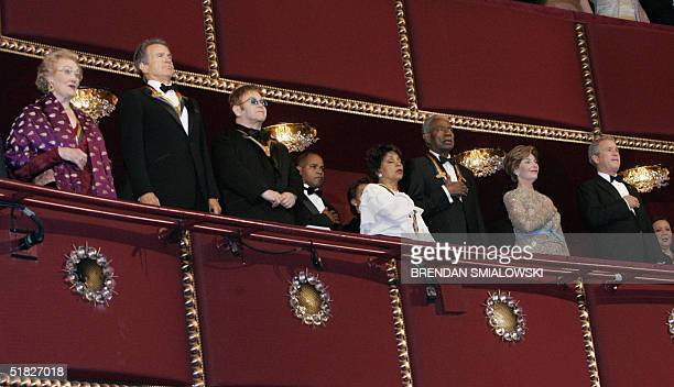 Joan Sutherland Warren Beatty Elton John Rudy Dee Ossie Davis US President George W Bush and First Lady Laura Bush listen to the National Anthem...