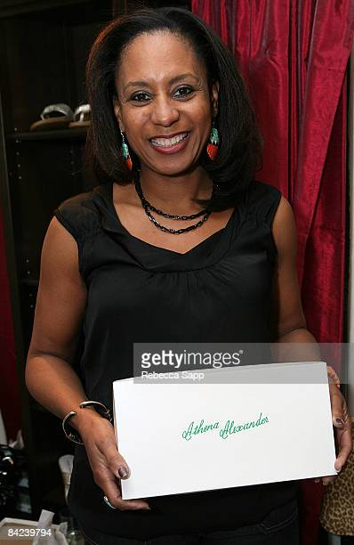 JoAn Turman poses with the JA Footwear Athena Alexander / Callisto of California / Lia Bijou display during the HBO Luxury Lounge in honor of the...