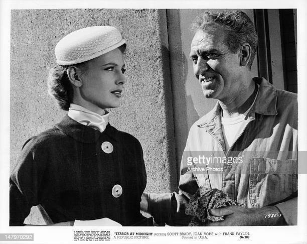 Joan Vohs looking at a smiling Frank Faylen in a scene from the film 'Terror At Midnight' 1956